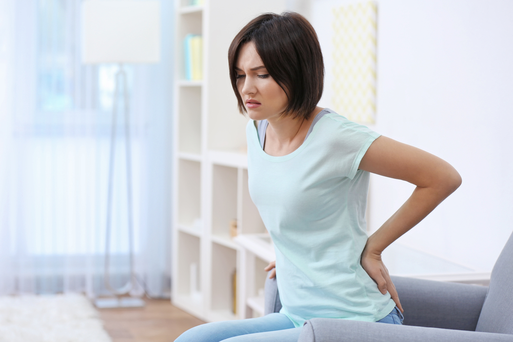 Woman with back pain due to Sciatica